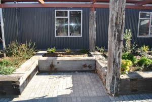 Garden edges and lean-to made from recycled rustic hardwoods.