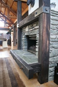 a fire place with finsihed hardwood surronds
