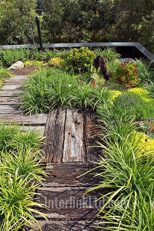 receessed railway sleepers form path in low garden
